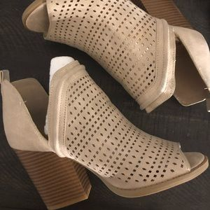 Peep toe laser cut boot heels